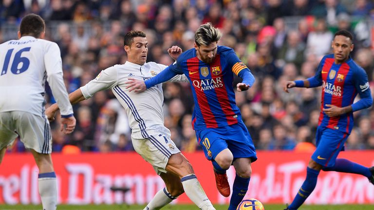 Lionel Messi (R) and Cristiano Ronaldo in La Liga action in 2016