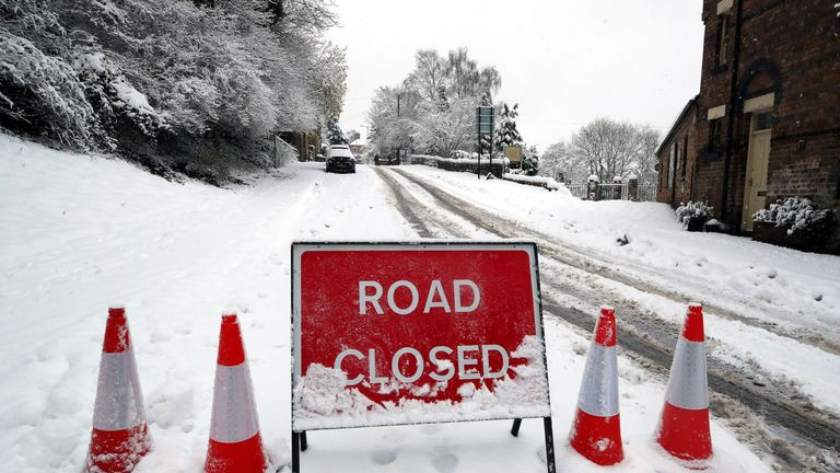 A road closed sign in snow covered Ironbridge in Shropshire, as heavy snowfall across parts of the UK is causing widespread disruption, closing roads and grounding flights at an airport.