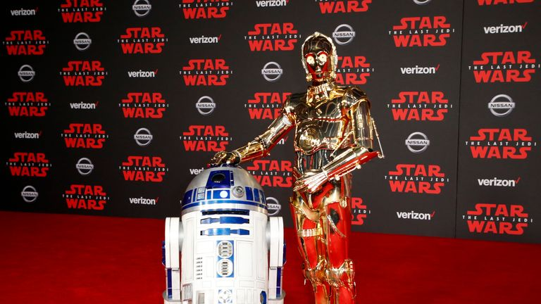 Droids R2-D2 and C-3PO posed on the red carpet