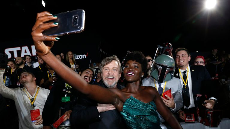 Mark Hamill and Lupita Nyong'o posed with fans for a selfie