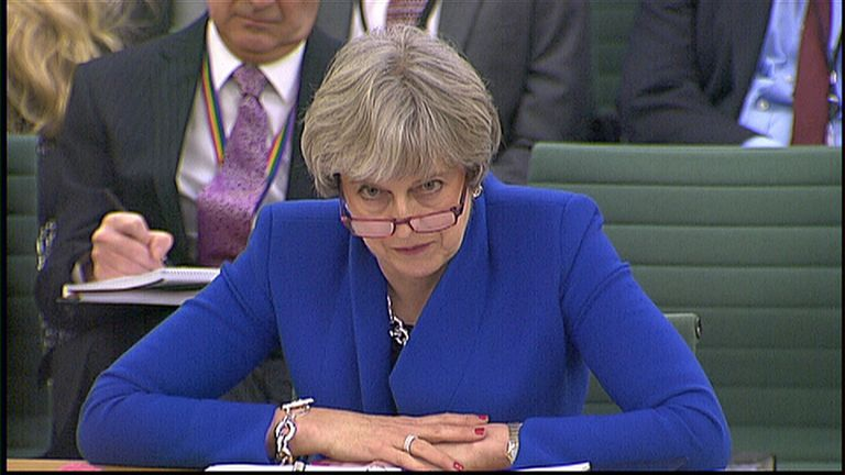 Theresa May in glasses