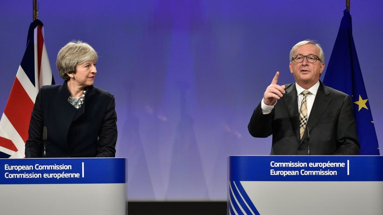 British Prime Minister Theresa May (L) and European Commission chief Jean-Claude Juncker give a press conference as they meet for Brexit negotiations on December 4, 2017 at the European Commission in Brussels