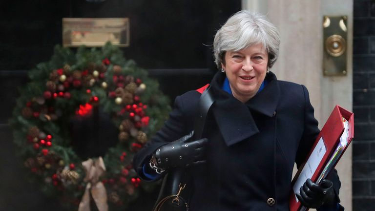 Britain's Prime Minister Theresa May leaves 10 Downing Street in central London on December 20, 2017 ahead of the weekly Prime Minister's Questions (PMQs) session in the House of Commons. May will face MPs questions in the House of Commons during the weekly PMQs session, following which she is set to be grilled by the Liaison Committee, which is made up of the chairpeople of parliamentary committees, with Brexit preparations dominating the agenda. / AFP PHOTO / Daniel LEAL-OLIVAS (Photo credit s