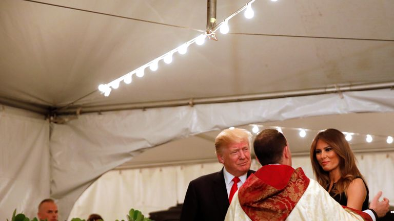 President and Mrs Trump at midnight Mass in Florida