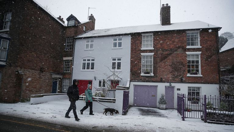 Dog walkers in Ironbridge, Shropshire, as parts of Britain woke up to a blanket of snow caused by an Arctic airflow in the wake of Storm Caroline
