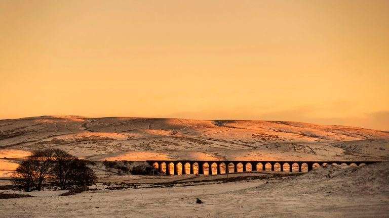Ribblehead Viaduct bathed morning sunlight in Yorkshire