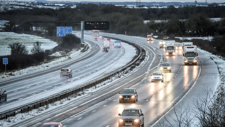 Snow reduces the M5 motorway down to two lanes between junction 14 and 15 in South Gloucestershire