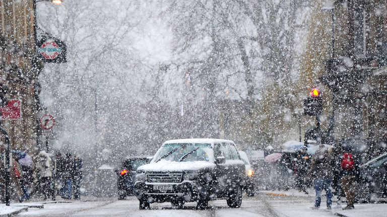People drive through the snow in York after Britain saw one of the coldest nights of the year