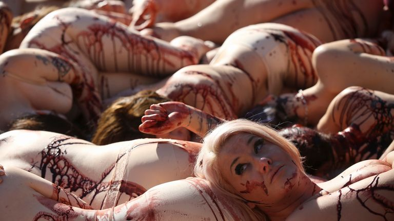 Around 100 people lie naked or partially clothed on the floor in Trafalgar Square covered in fake blood as part of a PETA protest against the meat and fishing industry and to make people aware of World Vegan Day in London on November 1, 2014. AFP PHOTO / ANDREW COWIE (Photo credit should read ANDREW COWIE / AFP,ANDREW COWIE/AFP/Getty Images)