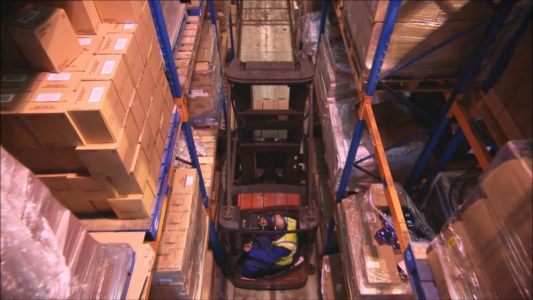Forklift inside warehouse.