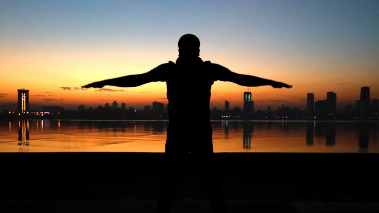 A man exercises early in the morning along the Arabian Sea in Mumbai, India