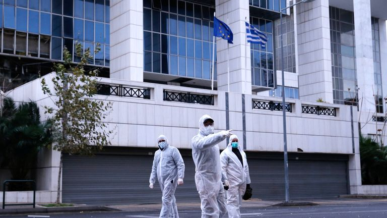 Police officers search for evidence after a bomb blast at a Court building in Athens, Greece