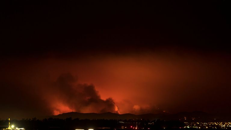 A wildfire burns on the hills of Ventura County