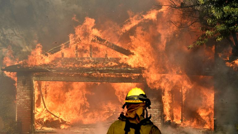 Firefighters battled to put out a house on fire in the San Fernando valley north of Los Angeles