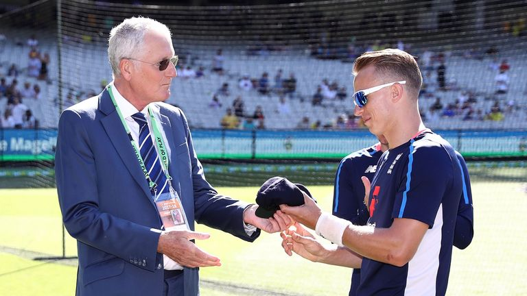 MELBOURNE, AUSTRALIA - DECEMBER 26:  Tom Curran of England receives his Test Cap from former England Cricketer Bob Willis during day one of the Fourth Test