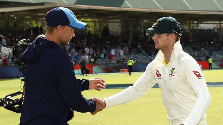 Joe Root of England and Steve Smith of Australia shake hands after Australia claimed victory