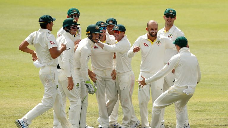 Nathan Lyon of Australia celebrates the wicket of Joe Root of England during day four of the Third Test