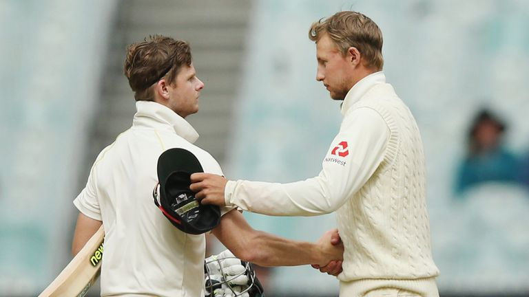 Steve Smith of Australia (L) and Joe Root of England shake hands after the drawn result in the Fourth Test