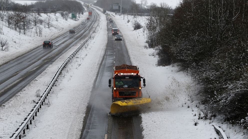 A snow plough clears the A14 after a snow fall near Kettering