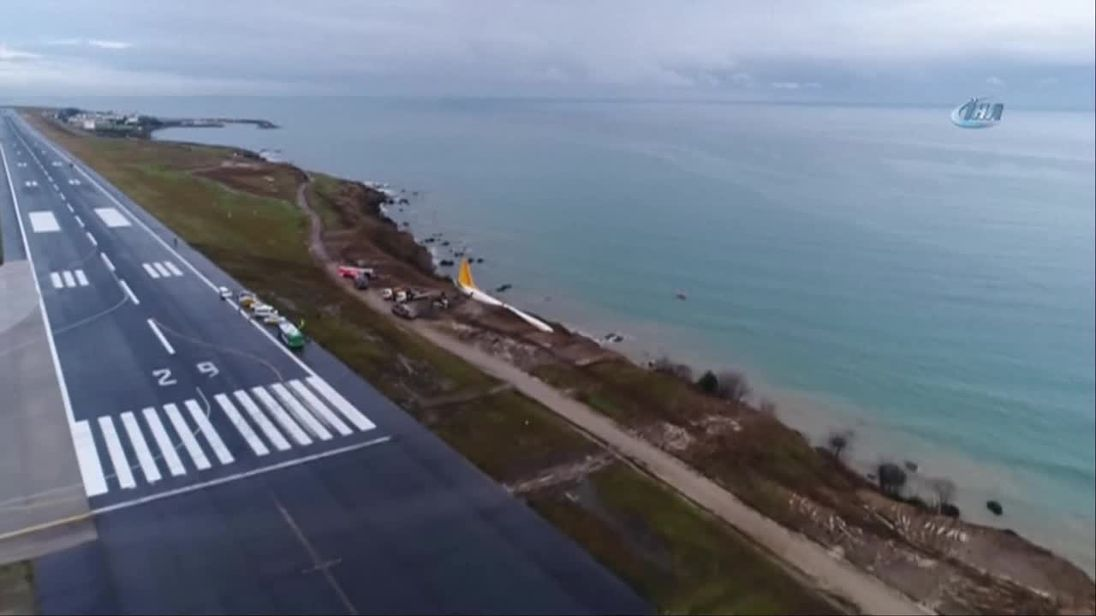Plane skids off runway and dangles over a cliff