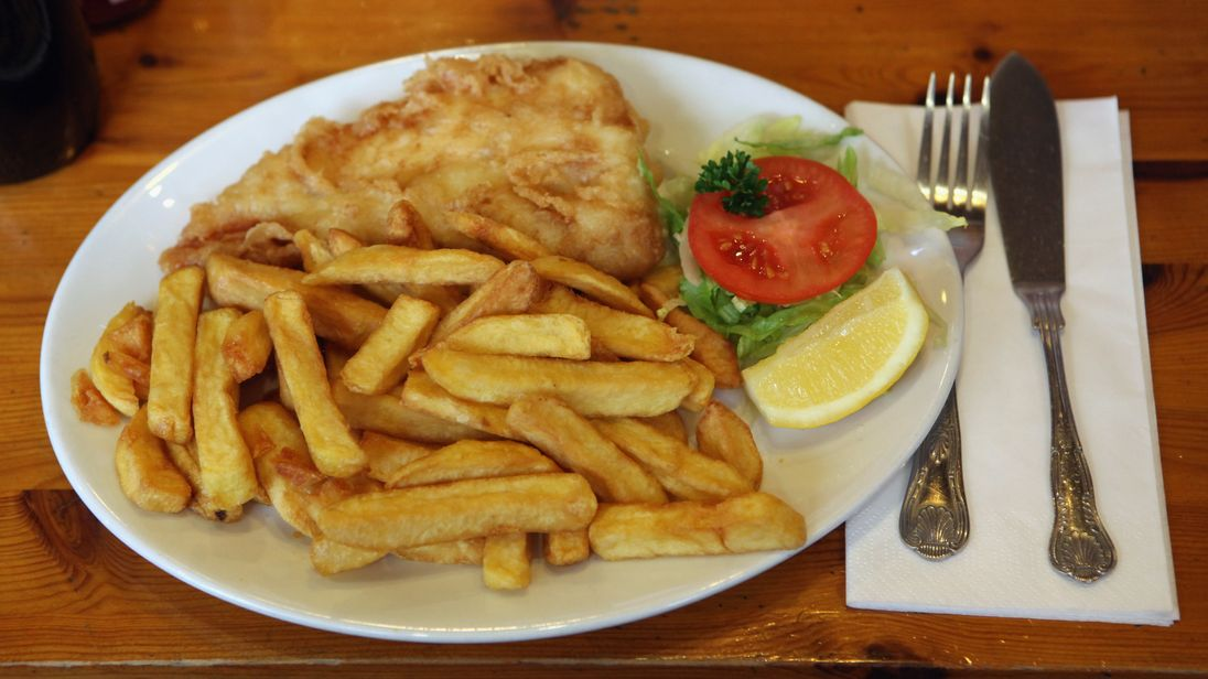 LONDON, ENGLAND - FEBRUARY 22:  A traditional portion of fish and chips is prepared in Olley's fish restaurant on February 22, 2011 in London, England.  ho