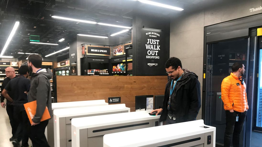 AMAZON.COM-STORE/SYSTEM IDENTIFIER:RTX4GUK1CODE:RC141E8E4BF0MEDIA DATE21 Jan. 2018PHOTOGRAPHER:Jeffrey DastinHEADLINE:A shopper scans a smartphone app associated with his Amazon account and credit card information to enter...SIZE:4032px × 2961px (~34 MB)