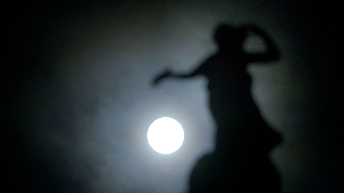 The New Year supermoon - also known as a Wolf Moon - pictured at its fullest in the middle of the night of the 2nd of January behind Thomas Clapperton's bronze statue called Literature which sits on top of the Mitchell Library, Glasgow, Scotland. PRESS ASSOCIATION Photo. Picture date: Tuesday January 2, 2018. See PA story WEATHER Supermoon. Photo credit should read: John Linton/PA Wire