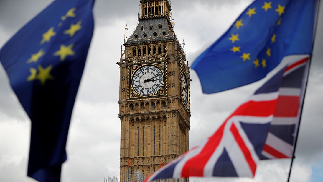 The Union Flag and European Union flags fly near the Elizabeth Tower, during the anti-Brexit 'People's March for Europe'