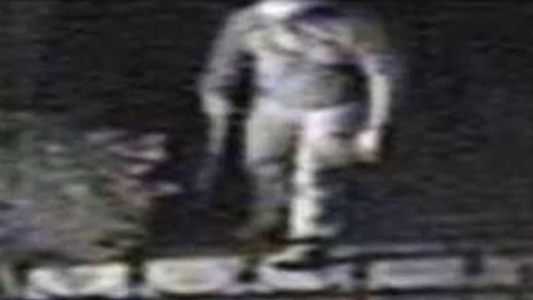 CCTV still issued by Surrey Police of raid by an armed burglar at a house in Maidenhead