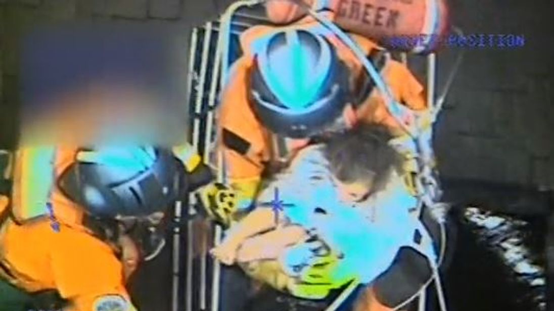 A Coast Guard MH-60T Jayhawk helicopter crew from Coast Guard Sector San Diego rescues a family of five, including a newborn, seven-year-old son, three-year-old daughter and two dogs, in Santa Barbara County, California after a mudslide, Jan. 9, 2018. Pic: US Coast Guard