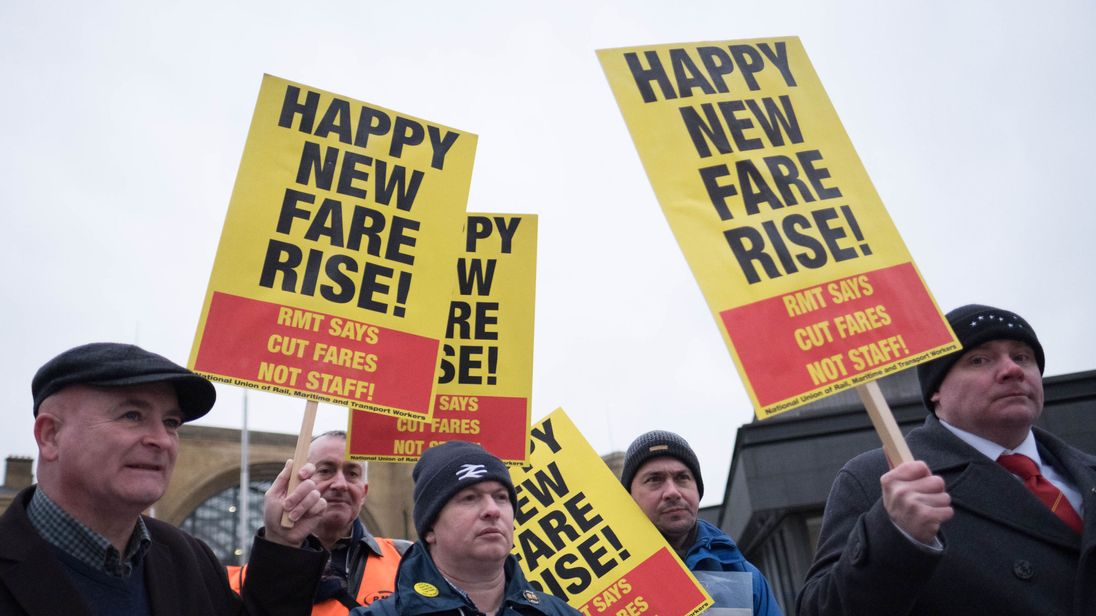Campaigners protest against rail fare increases outside King's Cross station in London