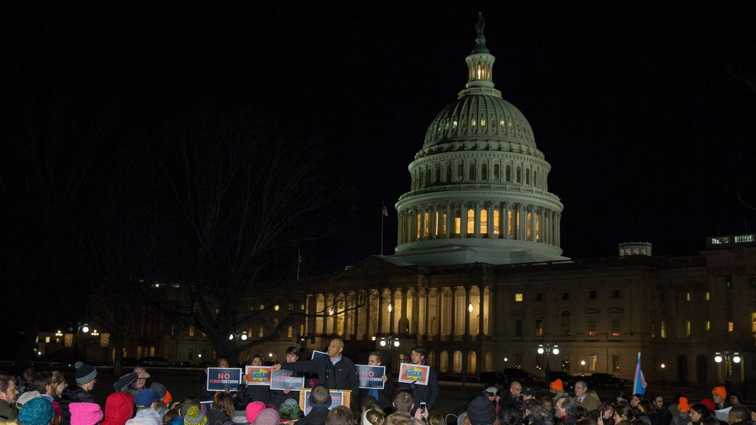 Protesters outside the Capitol building as the US Government shuts down
