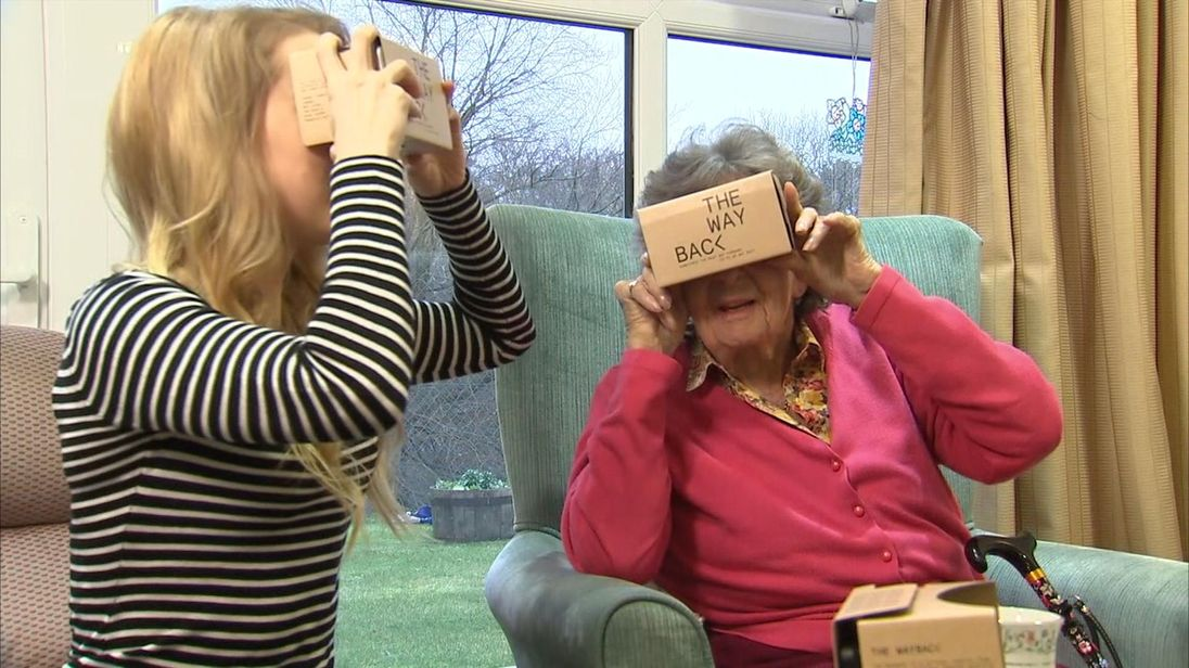 Presenter Gemma Evans and care home resident Daphne try the virtual reality headset