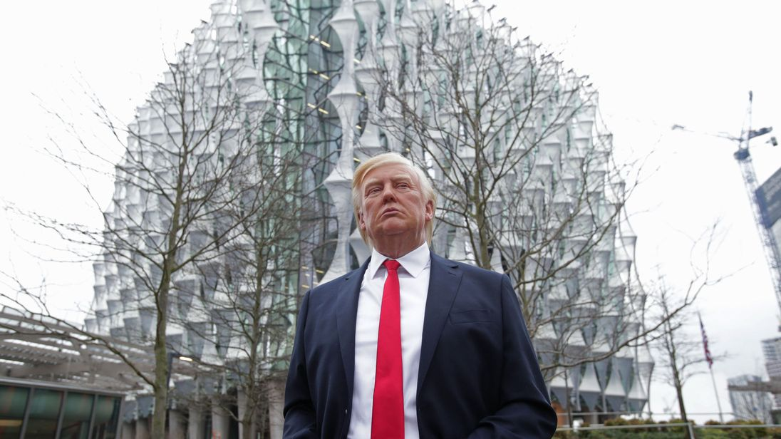 The Madame Tussauds wax figure of US President Donald Trump outside the new US Embassy in Nine Elms, London, after Mr Trump confirmed he will not travel to the UK to open the new building - and hit out at the location of the 1.2 billion dollar (�886 million) project.