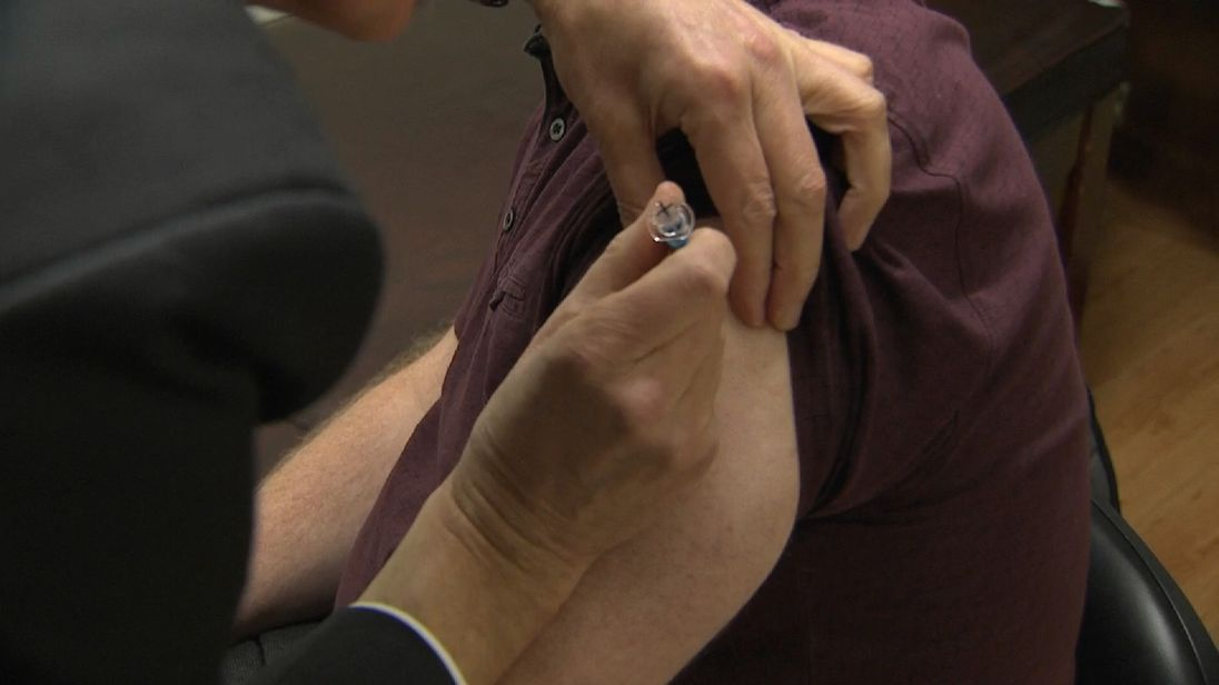 A man receives a vaccination for 'A strain' flu.