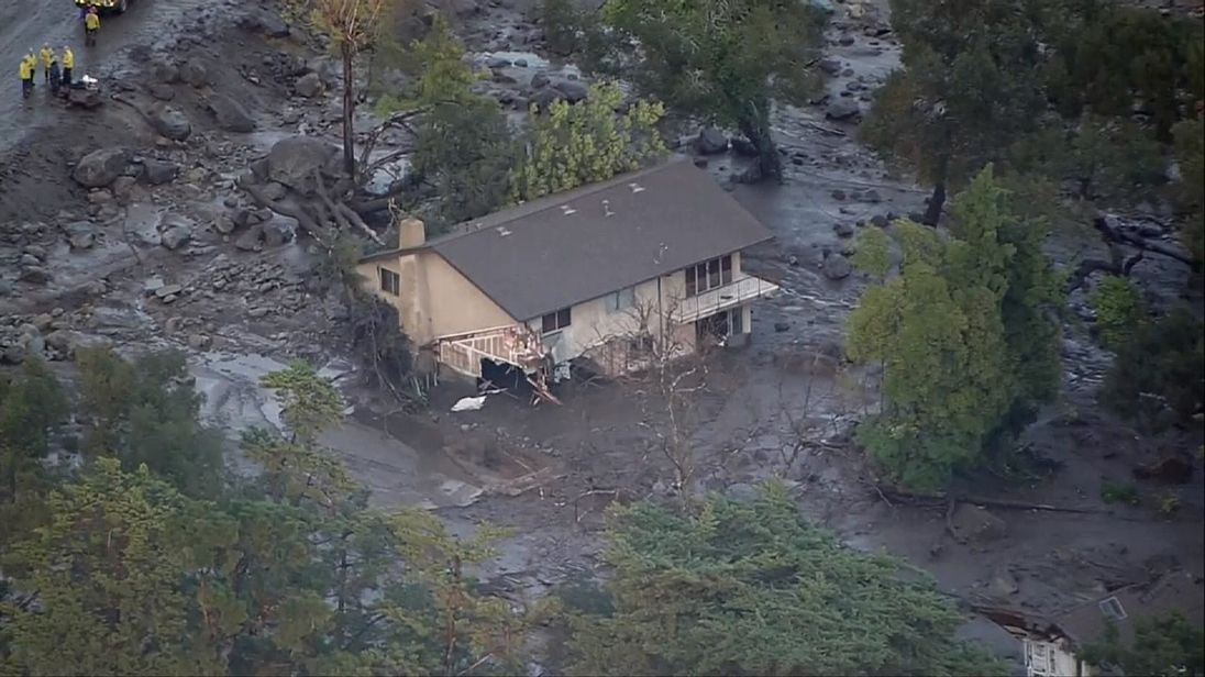 A house lies damaged following the mudslides in California