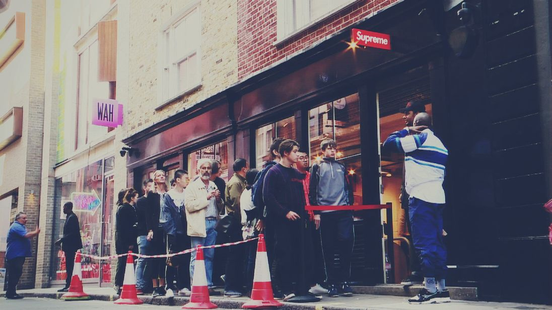 Shoppers queue outside the Supreme shop - a hypebeast's favourite.