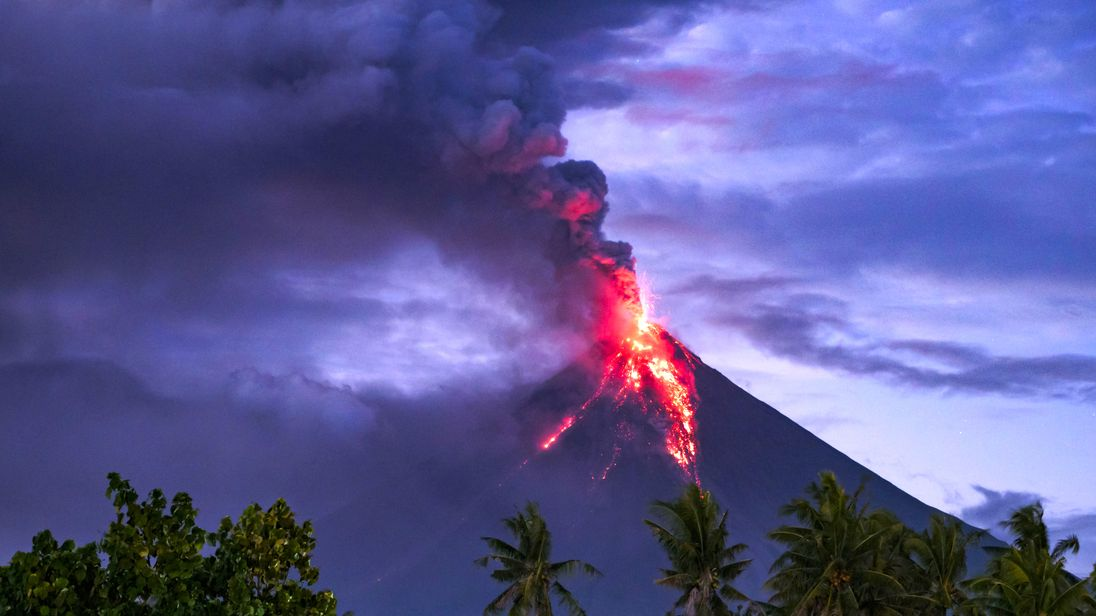 Incredible images show lava, ash spewing from Philippine volcano