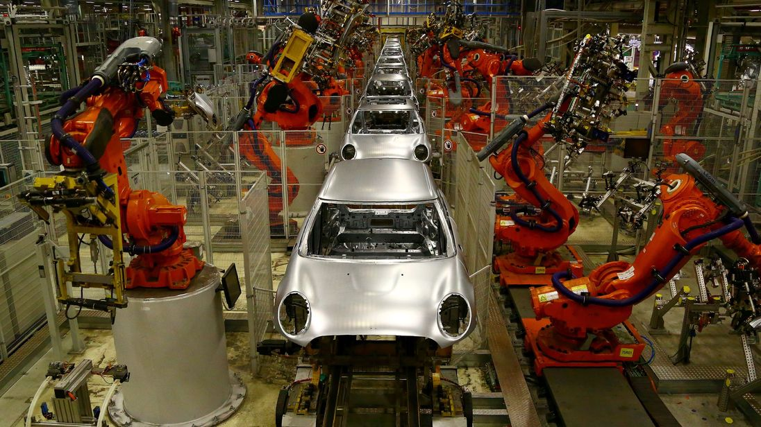 Minis in the 'Body in white' stage of manufacture pass on the production line at the BMW Mini car production plant in Oxford