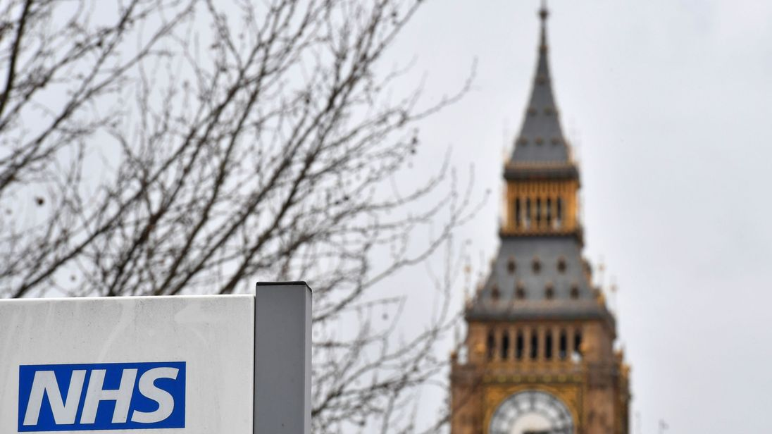 A NHS (National Health Service) sign is pictured outside St Thomas' Hospital, near the Houses of Parliament, in central London on March 8, 2017. Britain's economy will grow by 2.0 percent this year, sharply up on a previous forecast of 1.4 percent, finance minister Philip Hammond said Wednesday in his budget statement. Hammond also announced a two billion pound increase in spending for social care, over the next three years, in an effort to tackle pressure on the NHS.