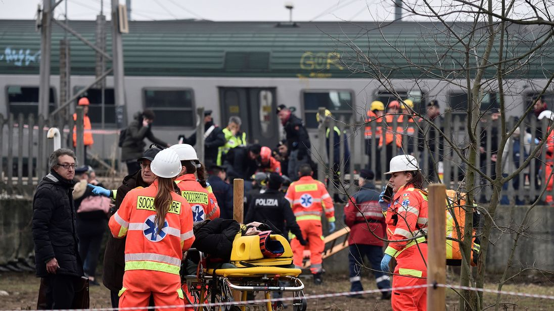 Two dead and dozens injured as train derails near Milan, Italy