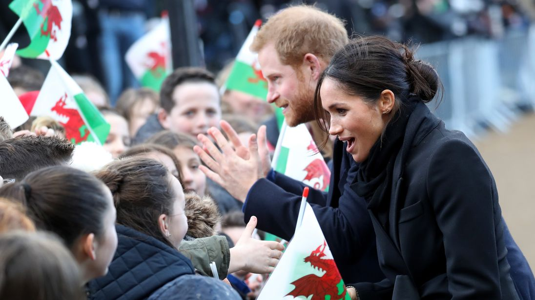 Prince Harry and his fiancee Meghan Markle are seen during a walkabout at Cardiff Castle