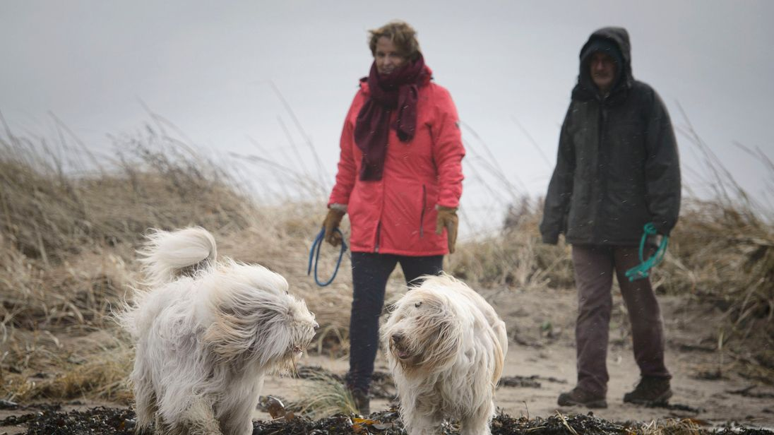 Dog walkers in Troon, Ayrshire, were faced with up to 100mph winds from Storm Eleanor