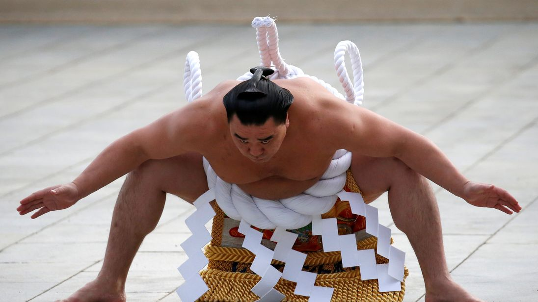 Yokozuna Harumafuji was fined for hitting a junior wrestler with a karaoke remote