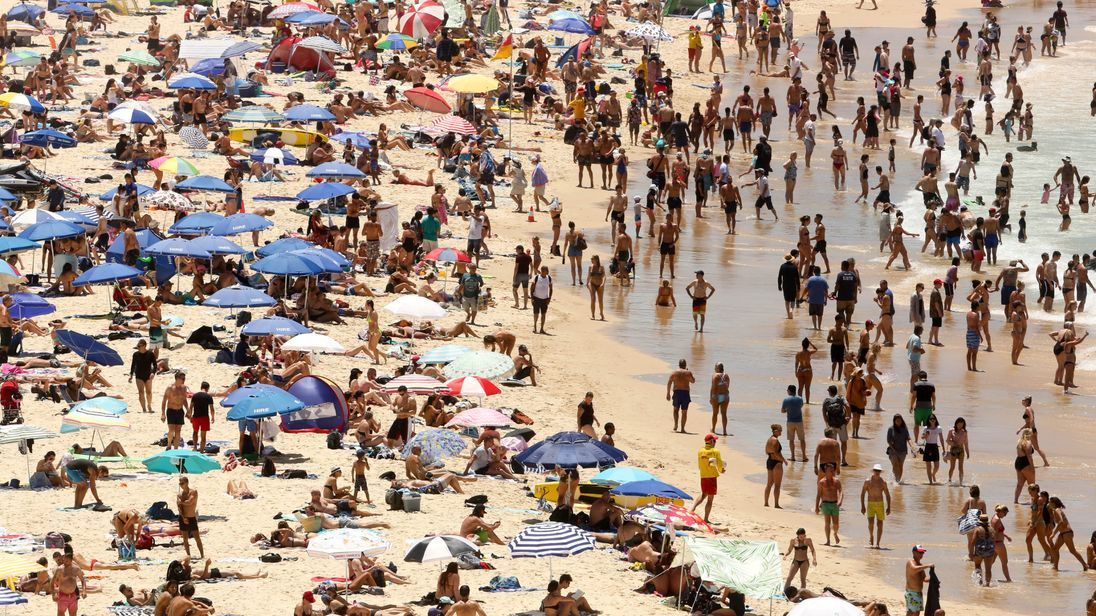 Temperatures reach 79-year high as Sydney residents flock to the beaches