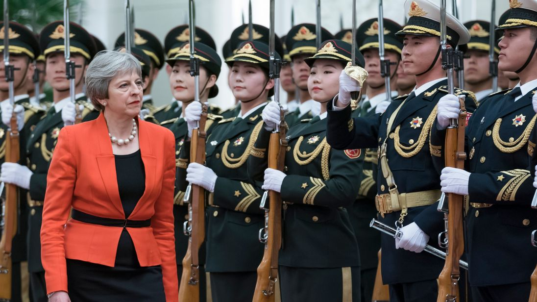 Theresa May gets an honour guard at a welcoming ceremony in Beijing