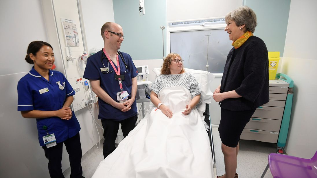 Mrs May spoke to patients and staff on a visit to Frimley Park Hospital in Surrey