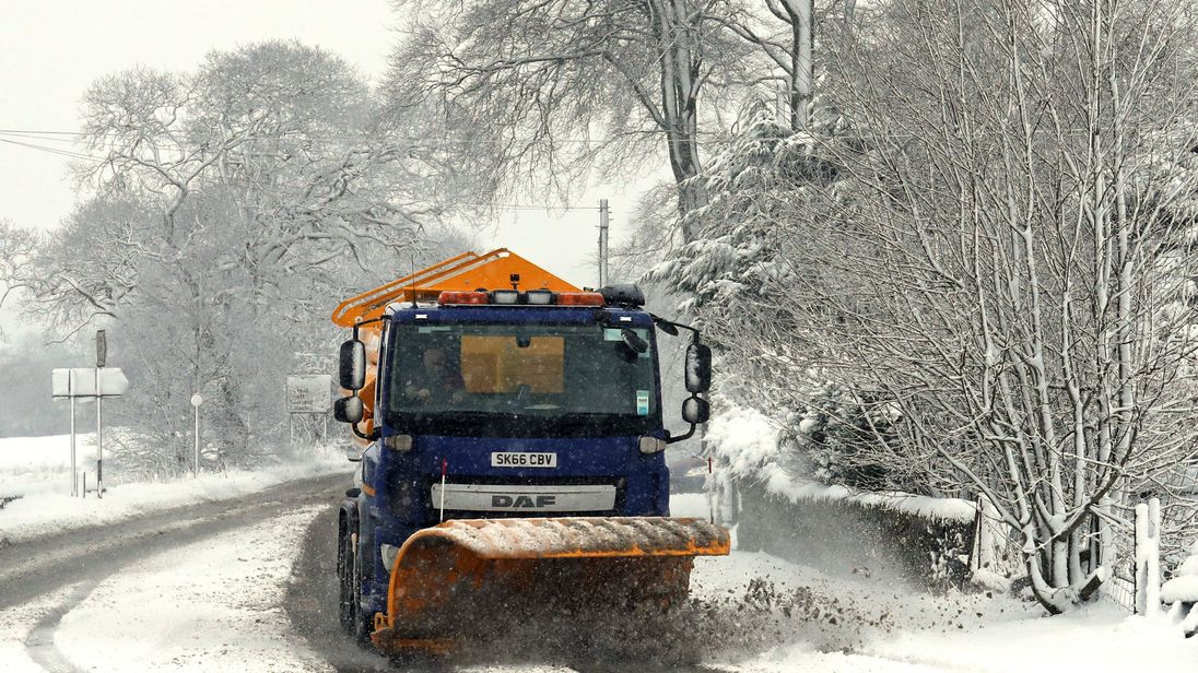 A snow plough clears the road close to Greenloaning in Perthshire