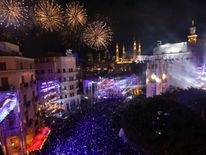 Fireworks explode over downtown Beirut, Lebanon, during New Year's celebrations, on January 1, 2018