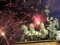 Fireworks explode over the Brandenburg Gate during New Year's festivities on January 1, 2018 in Berlin, Germany